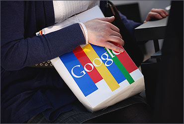 A visitor clutches a paper bag from online giant Google at the CeBIT technology trade fair.