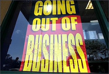 A sign is displayed in the window at a Borders Bookstore.