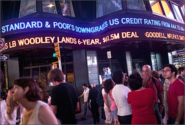 An ABC News ticker reads Standard and Poor's downgrades US credit rating.