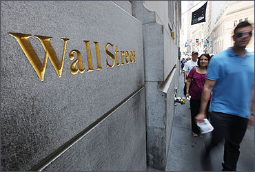 People walk on Wall Street outside the New York Stock Exchange.