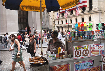 A food vendor is stationed in front of the New York Stock Exchange.