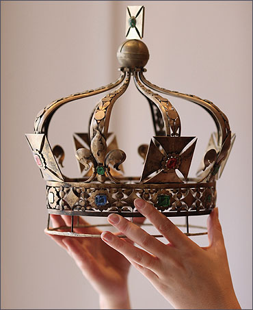 A woman holds a model used in the production of the Imperial State Crown of India.