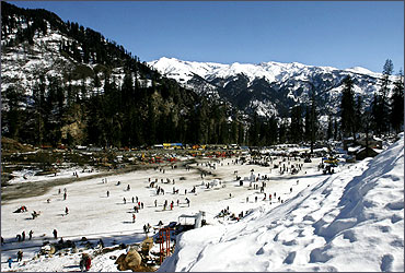 Tourists ski in Solang Valley in the northern Indian state of Himachal Pradesh.