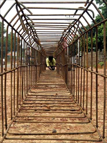 A labourer works at a road construction site on the outskirts of Agartala.
