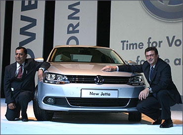 Neeraj Garg Member of Board and director, Volkswagen Passenger Cars and Lutz Kothe head of marketing and PR pose with the car.
