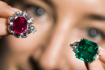 A 7.03 carat oval-shaped Burmese ruby and a 12.79 carat Colombian emerald and diamond ring in Geneva.