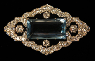 An aquamarine and diamond brooch is displayed at Bentley and Skinner jewellers in London,