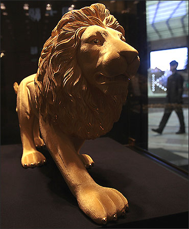 A gold statue of a lion is displayed at a jewellery shop in Hong Kong.