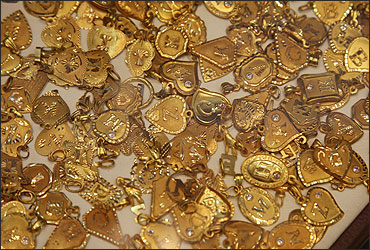 Gold souvenirs are displayed at jewellery shop in Amman.