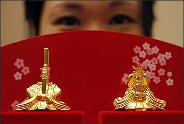 Japanese ornamental hina dolls, made of pure gold, is unveiled at the Ginza Tanaka store in Tokyo.