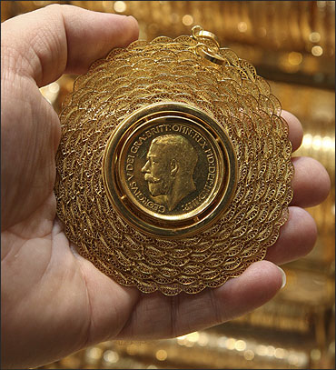 A man shows a gold medal in his shop in Damascus.