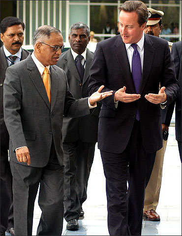 Narayana Murthy with  British Prime Minister David Cameron at the Infosys campus in Bangalore.