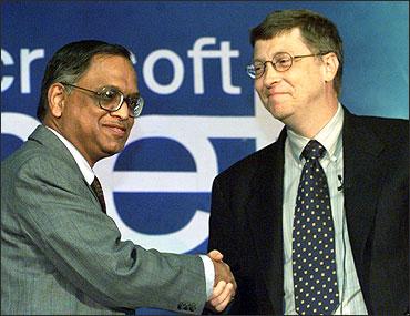 Chairman of Microsoft Corporation Bill Gates (R) shakes hands with N R Narayana Murthy.