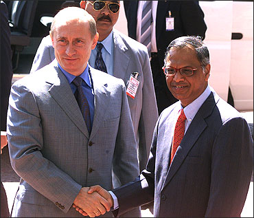 Russian President Vladimir Putin (L) shakes hands with N R Narayana Murthy.