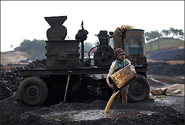 A boy works at a coal depot Lad Rymbai, in the district of Jaintia Hills.