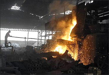 A labourer works in an iron factory.