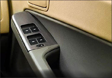 Tata Indica Vista driver's side inside door control.
