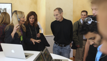Steve Jobs inspects Apple's products.