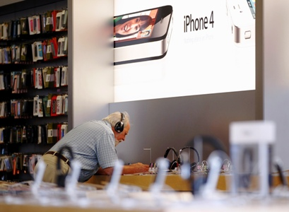 A customer looks over products at an Apple retail store in San Francisco, California.