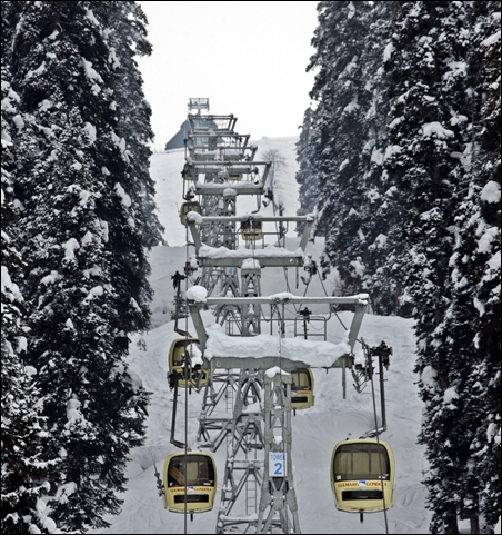 Skiers and tourists use cable car gondolas to reach upper reaches of Gulmarg, 55 km west of Srinagar.