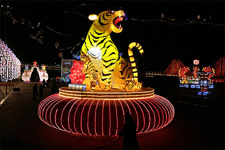 A tiger lantern is seen at the gate of Longqingxia valley at the Yanqing ice and snow festival.
