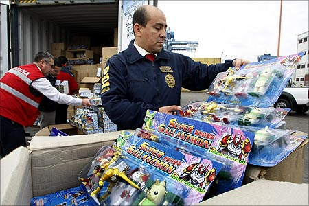 A member of Chile's investigative police inspects a shipment of toys from China.
