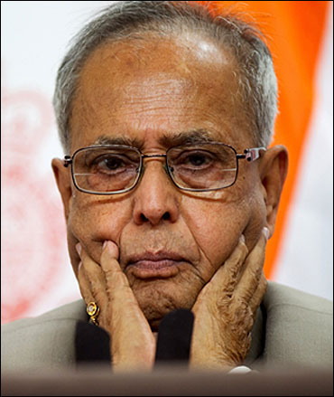 Finance Minister Pranab Mukherjee is all attention at a press conference.