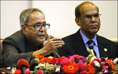Finance Minister Pranab Mukherjee (L) speaks as Reserve Bank of India's (RBI) Governor Duvvuri Subbarao watches.