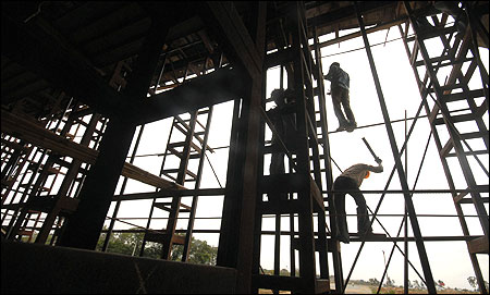 Labourers work on a flyover.