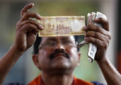 The fall of the Indian rupee: How it helps NRIs