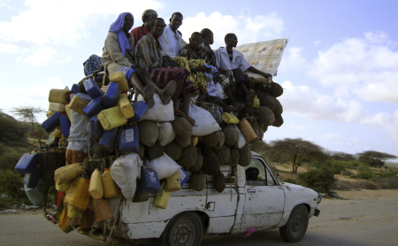 Residents ride on a pick-up truck that supplies milk and other items in Somalia's capital Mogadishu.