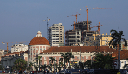 Office blocks under construction stand behind the Angolan central bank building in capital Luanda.