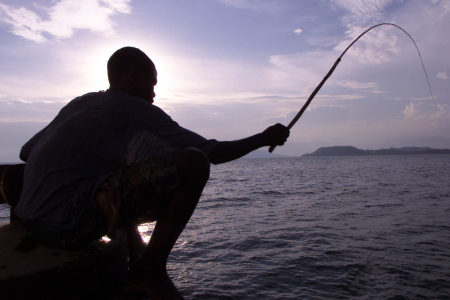 A fisherman casts his line in Lake Kivu, Goma.