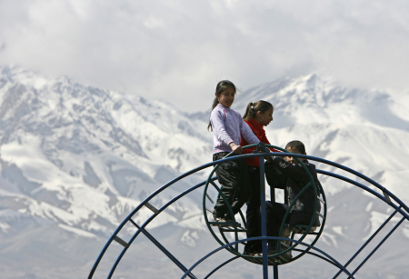 Children ride on a Ferris wheel in Kabul.
