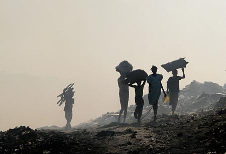 Haitian women walk down a street in Port-au-Prince.