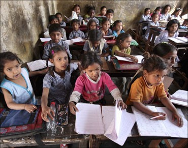 Students study in a classroom of a government-run school