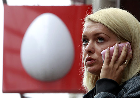 A woman speaks on the phone near an office of Russia's mobile phone operator MTS.