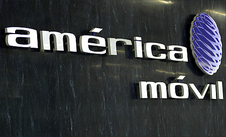 The logo of America Movil is seen on the wall of the reception area in the company's new corporate offices in Mexico.