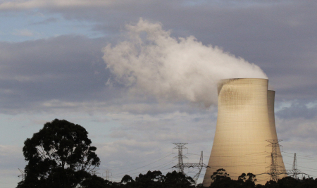 Steam raises from the cooling towers of a coal power station in Australia.