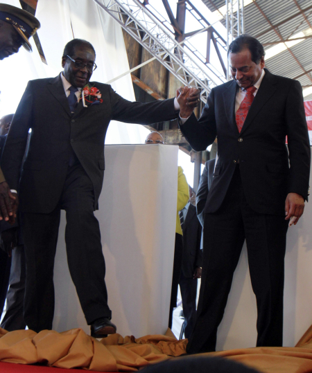 Zimbabwe's President Robert Mugabe, left, with Essar's Ravi Ruia in Redcliff, Kwekwe, east of Harare.