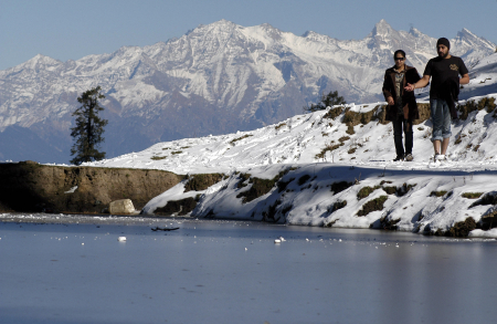 Tourists visit an area covered in snowfall in Narkanda.