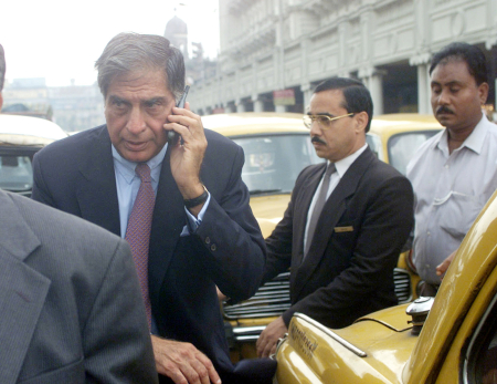 Ratan Tata talks on his mobile phone while looking for a taxi on a jammed road in Kolkata.