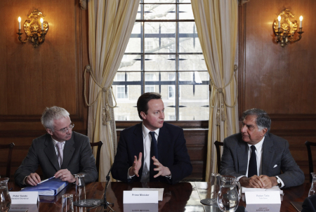 Britain's Prime Minister David Cameron, centre,  is flanked by CEO of Standard Chartered Peter Sands, left.  and Ratan Tata  at Number 10 Downing Street in London.