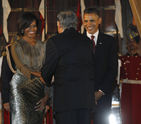 US President Barack Obama and First Lady Michelle Obama greet Ratan Tata in New Delhi.