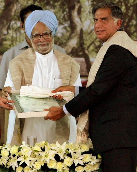 Prime Minister Manmohan Singh presents Ratan Tata with an honourary degree in Mumbai.