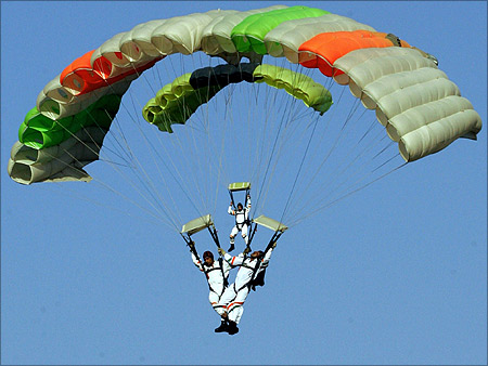 Indian Air Force sky divers parachute at Hindon airport in Ghaziabad.