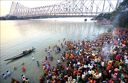 Hindu devotees worship the Sun god on the banks of the river Ganges on the occasion of Chhat Puja in Kolkata.