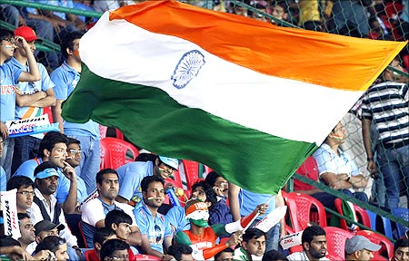 A fan waves the Indian national flag before the ICC Cricket World Cup