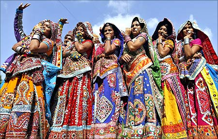 Dancers dressed in traditional attire pose after taking part in rehearsals for the Garba in Ahmedabad.