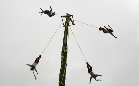Men from Papantla perform the flying rope ritual by descending from the top of a 30-foot-high wooden post during the cultural carnival in Valparaiso.